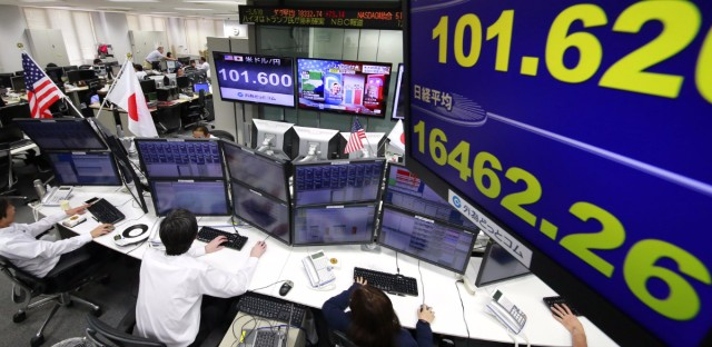 Money traders watched computer screens at a foreign exchange brokerage in Tokyo on Wednesday as U.S. presidential ballots were counted.
