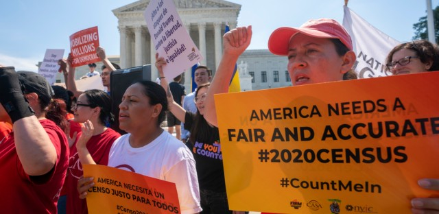 Demonstrators gather Thursday at the Supreme Court as the justices meet to finish the term. Local officials and community groups in Illinois are praising the court's decision to temporarily block a citizenship question from the 2020 census.