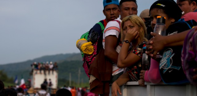 Migrants hitch rides on passing truck as they continue on their journey after Mexican police briefly blockaded the road to keep them from advancing, outside the town of Arriaga, Mexico, Saturday, Oct. 27, 2018. Hundreds of Mexican federal officers carrying plastic shields briefly blocked the caravan of Central American migrants from continuing toward the United States, after several thousand of the migrants turned down the chance to apply for refugee status and obtain a Mexican offer of benefits.