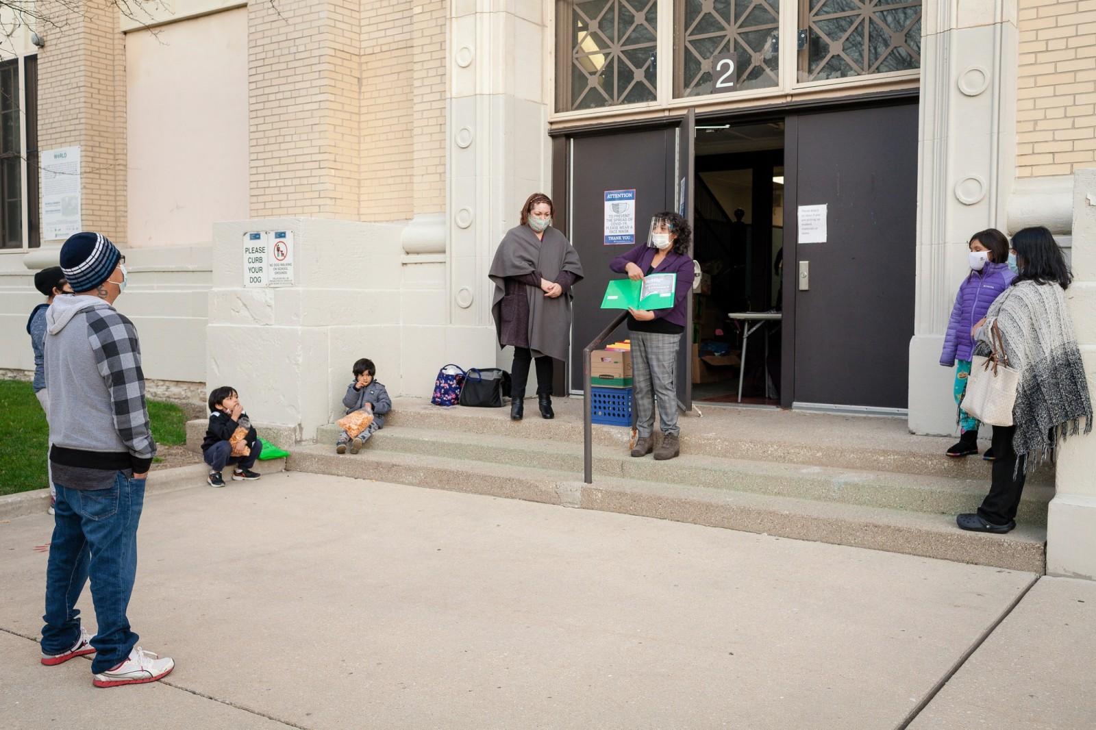 Olga Contreras distributing worksheets