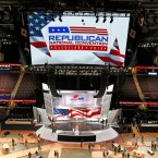 Workers put the finishing touches on the convention floor at the Quicken Loans Arena in downtown Cleveland, Ohio, in preparation for the upcoming Republican National Convention.