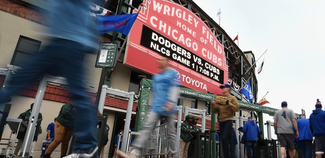 Fans walk outside Chicago's Wrigley Field prior to Game 1 of the National League Championship Series between the Chicago Cubs and the Los Angeles Dodgers on Oct. 15.