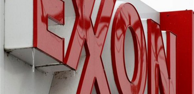 An Exxon sign is displayed atop a mini-market. Exxon Mobil is ranked number 2 on the Fortune 500 list.