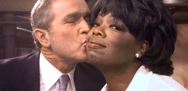 Then-Republican presidential candidate Texas Gov. George W. Bush kisses talk show host Oprah Winfrey