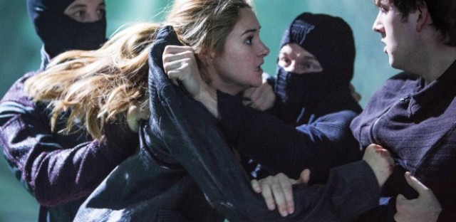 """This publicity photo released by Summit Entertainment shows Shailene Woodley, left, and Christian Madsen in a scene from the film, """"Divergent."""""""