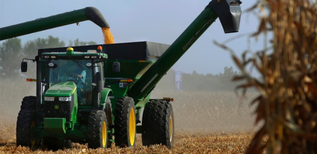Central Illinois farmers harvest their corn crops on Sept. 14, 2016, in Loami, Ill.