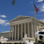 The Supreme Court had been planning to hear lawsuits over President Trump's travel ban next month.