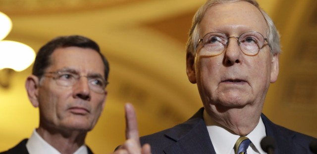 Senate Majority Leader Mitch McConnell of Kentucky gestures to reporters on Capitol Hill at a press conference on May 23. (Jacquelyn Martin/AP)