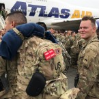 Soldiers from the 1st Armored Division, based in Fort Bliss, Texas, arrives at the airport Tegel in Berlin, Thursday, March 21, 2019. Over three hundred soldiers have arrived in Germany from their base in Texas in the first test of a new American strategy to rapidly deploy troops based in the United States to Europe to bolster the NATO deterrent against possible Russian aggression.