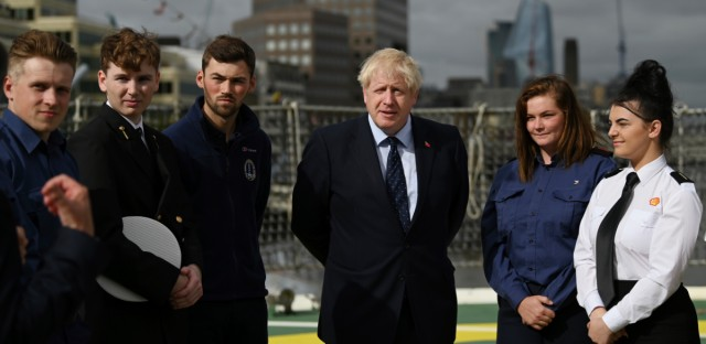 Britain's Prime Minister Boris Johnson speaks to apprentices as he visits the NLV Pharos, a lighthouse tender moored on the river Thames, to mark London International Shipping Week in London, Thursday, Sept. 12, 2019. The British government insisted Thursday that its forecast of food and medicine shortages, gridlock at ports and riots in the streets after a no-deal Brexit is an avoidable worst-case scenario, as Prime Minister Boris Johnson denied misleading Queen Elizabeth II about his reasons for suspending Parliament just weeks before the country is due to leave the European Union.