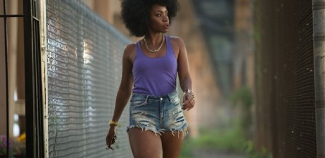 """This photo provided by Roadside Attractions and Amazon Studios shows Teyonah Parris as Lysistrata in Spike Lee's film, """"Chi-Raq."""" The movie opens in U.S. theaters on Dec. 4, 2015."""