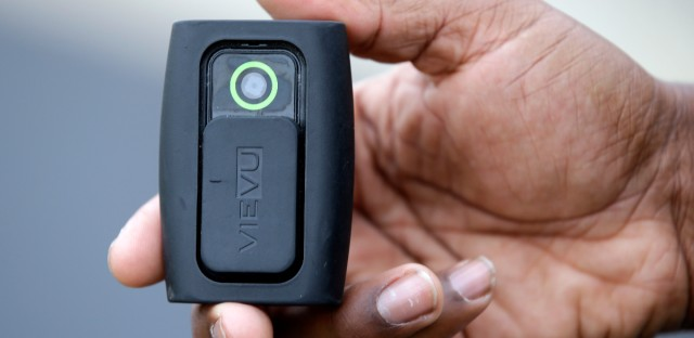 A police officer from Indiana holds the body camera he wears on his shift. Chicago police are investigating why the body camera of an officer involved in the fatal shooting of an unarmed 18-year-old last week was not recording at the time.