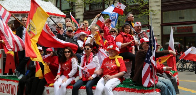 Festooned in Poland's national colors of red and white, Polish-American businesses, clubs and church organizations ride on floats during Chicago's annual Constitution Day Parade.