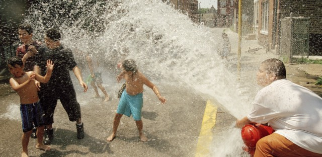 A group of kids uses a fire hydrant to cool down in the heat and humidity of Chicago on July 14, 1995. Temperatures neared 100 degrees for the second straight day.