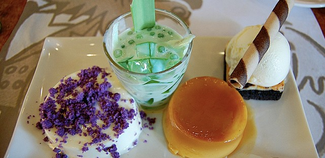Dessert sampler with buko pandan, cream cheese brownie à la mode, leche flan, and Ube Creme Decadence at Max's in Manila, Philippines