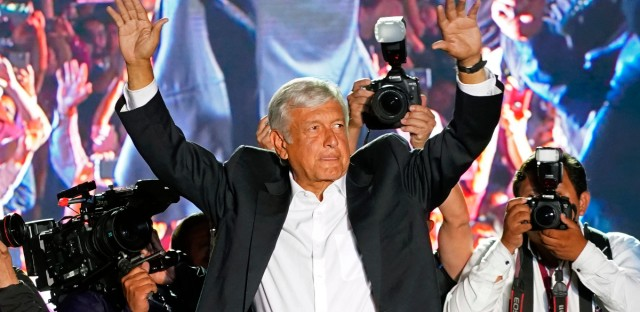 Presidential candidate Andres Manuel Lopez Obrador, of the MORENA party, waves to supporters as he arrives for his closing campaign rally at Azteca stadium in Mexico City, Wednesday, June 27, 2018. Mexico's four presidential candidates are closing their campaigns before the country's July 1 elections.