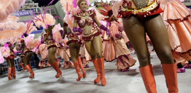 Performers from the Salgueiro samba school dance during carnival celebrations at the Sambadrome in Rio de Janeiro, Brazil, Monday, Feb. 8, 2016. (AP Photo/Silvia Izquierdo)