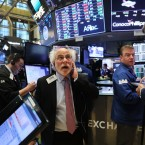 Traders work on the floor of the New York Stock Exchange last week. With its new record level, the blue chip index is now up 16 percent since the start of the year and about 26 percent since Election Day.