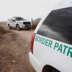 In this Thursday, Dec. 16, 2010 picture, U.S. Border Patrol vehicles drive from a checkpoint, as teams of border officers comb the Arizona desert about 10 miles north of Mexico in search for a suspect in the fatal shooting of U.S. Border Patrol agent Brian Terry in the rugged terrain in Rio Rico, Ariz.