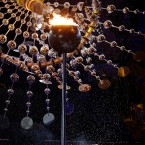 Mariene de Costa sings as the flame is extinguished during the closing ceremony in the Maracana stadium at the 2016 Summer Olympics in Rio de Janeiro, Brazil, Sunday, Aug. 21, 2016.