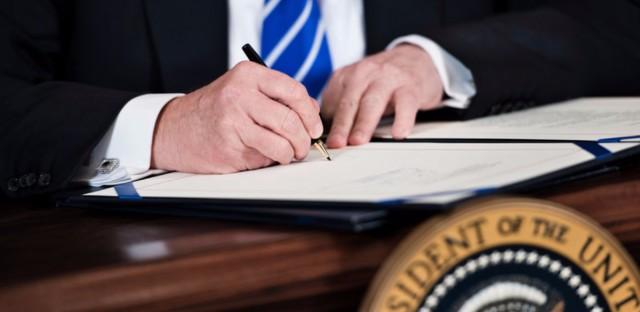 President Trump signs legislation dealing with benefits for slain law enforcement officers at the White House on June 2.