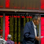 Chinese investors monitor stock prices at a brokerage house in Beijing, Monday, May 13, 2019. Shares were mostly lower in Asia on Monday after trade talks between the U.S. and China ended Friday without an agreement.