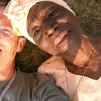 Andy Jones and Bi Kidude snap a selfie in the grass.