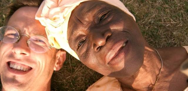 Andy Jones and Bi Kidude snap a selfie in the grass.