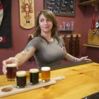 Craft breweries now account for 5,234 of 5,301 U.S. beer makers, according to an industry group's annual tally. Here, Danielle Coons, the tasting room ambassador at D.L. Geary Brewing Co. serves a beer in Portland, Maine, last November.