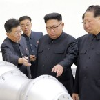 This undated picture released by North Korea's state-run news agency Sunday shows North Korean leader Kim Jong Un looking at what Pyongyang claims is a hydrogen bomb.