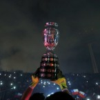 Chile's goalkeeper Claudio Bravo lifts the Copa America trophy after defeating Argentina in the final soccer match at the National Stadium in Santiago, Chile in 2015.