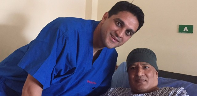 Dr. Ravi Bashyal poses with a hip replacement patient after he had just gotten up and walked for the first time. Bashyal says the surgery had profound psychological benefits as well.