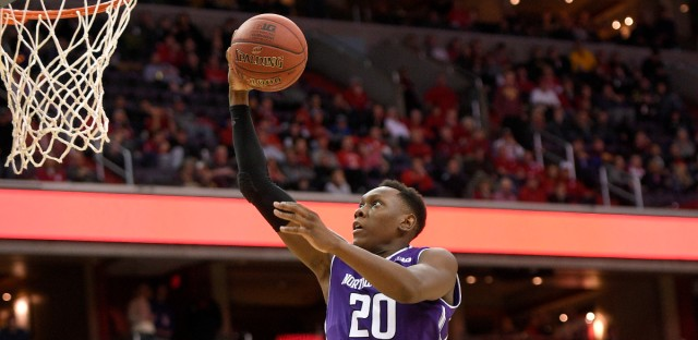 Northwestern guard Scottie Lindsey (20) goes to the basket past Wisconsin guard D'Mitrik Trice, right, during the second half of an NCAA college basketball game in the Big Ten tournament, Saturday, March 11, 2017, in Washington. Wisconsin won 76-48.