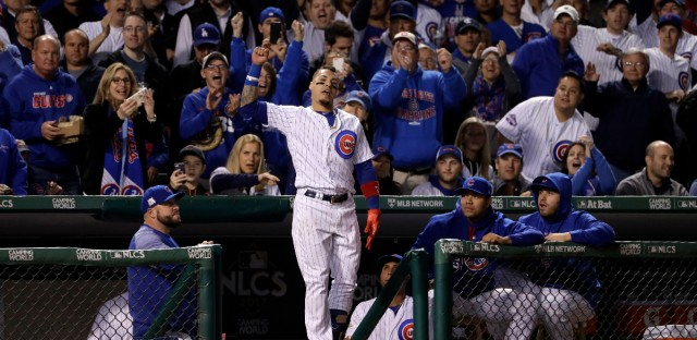 Chicago Cubs' Javier Baez celebrates after hitting his second home run during the fifth inning of Game 4 of baseball's National League Championship Series against the Los Angeles Dodgers, Wednesday, Oct. 18, 2017, in Chicago.