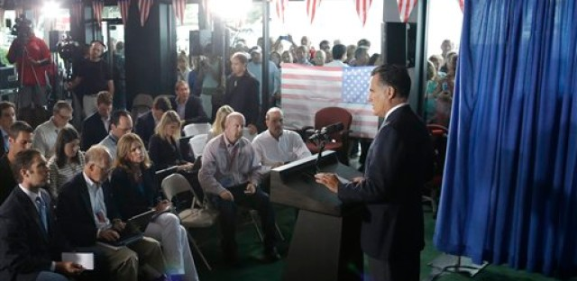Mitt Romney addresses the press.