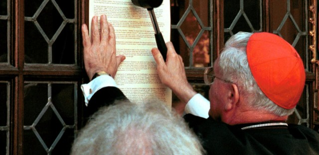 """The Lutheran and Roman Catholic churches signed a """"Joint Declaration on the Doctrine of Justification"""" putting aside their differences over the way humanity achieves salvation ending an almost 500-year debate that started when Martin Luther nailed his 95 theses to a church door."""