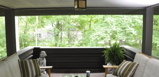 The home's semi-enclosed porch was restored by the owners.