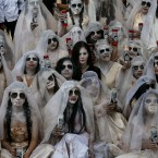 "Women dressed to depict ""La Llorana"" or ""The Weeping Woman"" take part in a street theater act to remember the 43 missing students from the Isidro Burgos rural teachers college, in Mexico City, Saturday, March 4, 2017. The 43 students at the teachers' college of Ayotzinapa disappeared in September 2014 and have not been heard from since they were taken by local police in in the city of Iguala in southern Guerrero state."