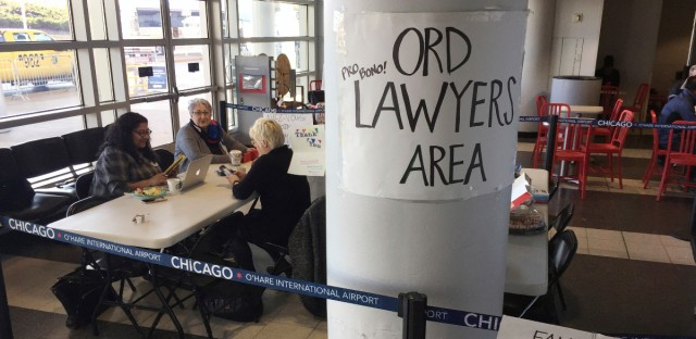 Volunteer lawyers wait at the international arrival area for travelers detained at O'Hare International Airport in Chicago, Friday, March 10, 2017. Some of the states that helped derail President Donald Trump's first travel ban are mounting efforts to block his second one, saying that while the new order applies to fewer people, it's infected with the same legal problems. (AP Photo/Charles Rex Arbogast)