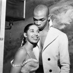 Announcing their engagement during a backstage reception for the Empress of Iran at New York's Alvin Theatre, Carmen De Lavallade gets a kiss from husband-to-be Geoffrey Holder. Both are dancers in the Broadway musical House of Flowers.