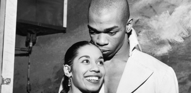 At a backstage reception for the Empress of Iran at New York's Alvin Theatre, Carmen De Lavallade gets a kiss from husband-to-be Geoffrey Holder. The photo is one of the more than one million images in the Ebony and Jet magazine archives that was sold Wednesday at a private auction.
