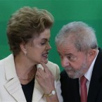Brazil's President Dilma Rousseff talks with former President Luiz Inacio Lula da Silva during his swearing-in ceremony as the chief of staff, at the Planalto presidential palace, in Brasilia, Brazil, Thursday, March 17, 2016. Silva was sworn in as his successor's chief of staff on Thursday and Rousseff insisted he would help put the troubled country back on track and denounced attempts to oust her.