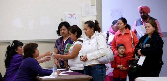 Lines like this one at a health insurance enrollment fair at the Ambrose Community Center in Bay Point, Calif., in 2014 may be longer this winter.