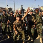 Iraqi security forces and volunteers celebrate in front of Governorate Council Building in Kirkuk, 290 kilometers (180 miles) north of Baghdad, Iraq, Monday, Oct. 16, 2017.