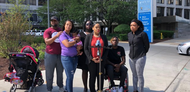 "Anti-violence activists, including Paris ""Tree"" Brown, with the youth-led activist group GoodKids, MadCity, and Camiella Williams, address the media outside of Mt. Sinai Hospital on Monday, Aug. 5, 2019."