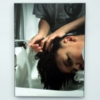 "A photo of a young girl getting her hair washed is one of many photos in artist Cecil McDonald Jr.'s ""In the Company of Black"" exhibit at the Chicago Cultural Center."