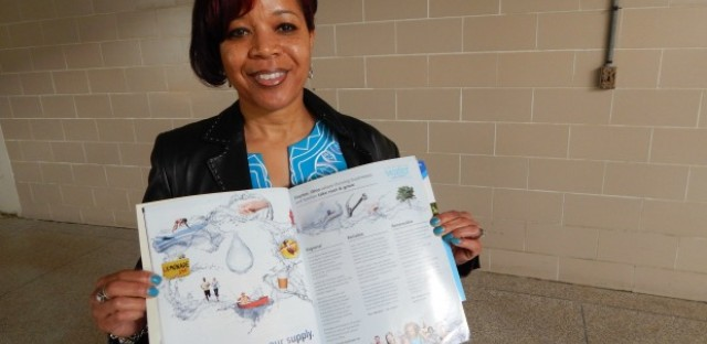 Karen Thomas, the city of Dayton's full-time water marketer, holds up a brochure advertising Dayton's water supply.