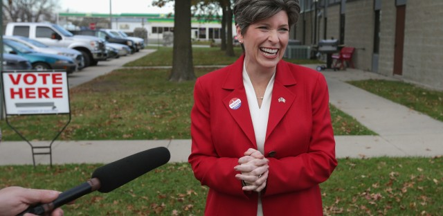 Sen. Joni Ernst speaks to members of the news media after casting her ballot on Election Day in 2014.