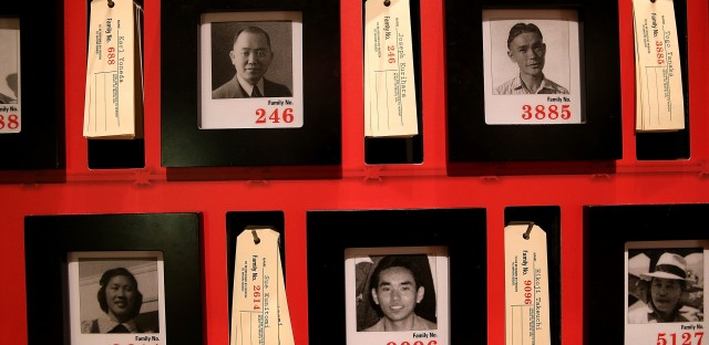 Pictures of people who were incarcerated at Manzanar War Relocation Center are displayed alongside family tags at Manzanar National Historic Site near Independence, Calif., in 2015.