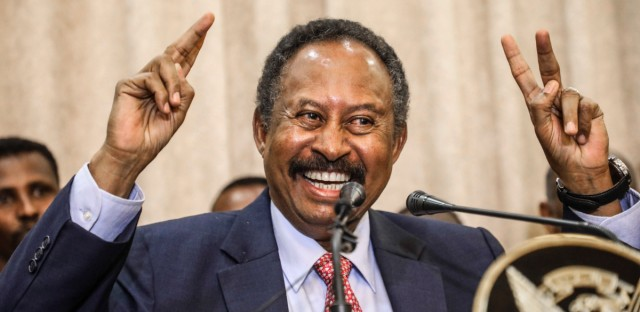 FILE - In this Wednesday, Aug. 21, 2019 file photo, Sudan's new Prime Minister Abdalla Hamdok speaks duringa press conference in Khartoum, Sudan, Wednesday, Aug. 21, 2019. For the first time in three decades, Sudan has charted a path out of military rule with the formation of a transitional government in which power is shared with civilians. But the fragile transition will be tested as leaders confront a daunting array of challenges. Decades of war and corruption have left the economy in shambles, and a U.S. terror designation has hindered Sudan's return from its longtime status as a global pariah.